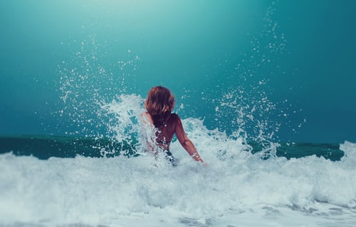 A woman in the ocean waves