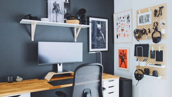 a stylish home office with black matte finished walls