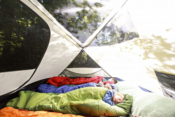 kids sleeping in a tent during daytime