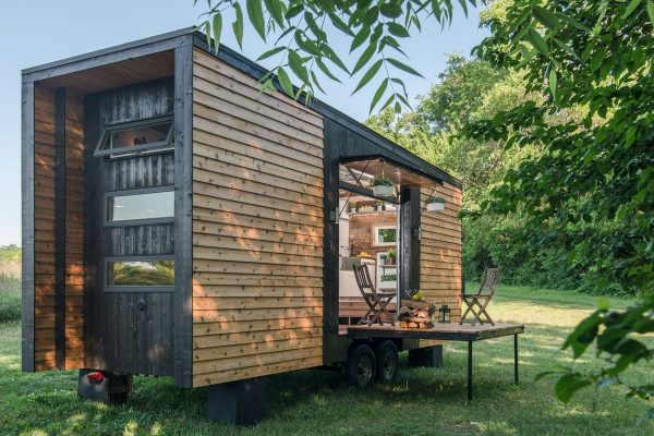 a tiny house with an outdoor area