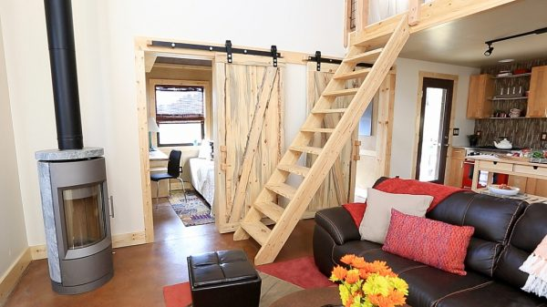 a tiny loft house with a ladder