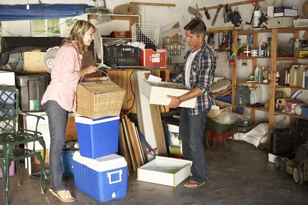 A couple organising their garage