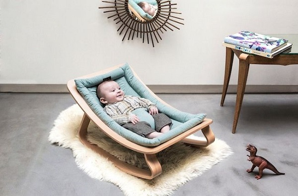 A baby in a rocking chair