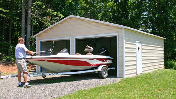 A man pushing a boat into the garage